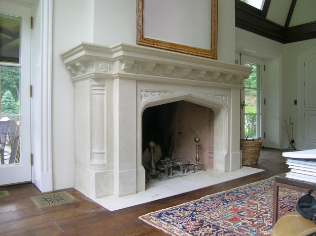 Neo gothic limestone mantel for Tudor style fireplace